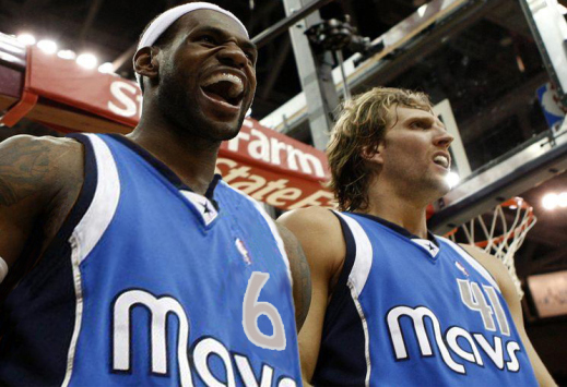 Cleveland Cavaliers LeBron James reacts after scoring and being fouled by Dallas Mavericks Dirk Nowitzki during the third quarter of their NBA basketball game
